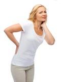 Unhappy woman suffering from backache Stock Photos