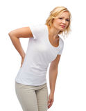 Unhappy woman suffering from backache Stock Images