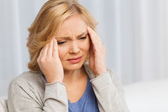 Unhappy woman suffering from headache at home Royalty Free Stock Image