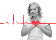 Unhappy woman suffering from heartache. People, healthcare, heart disease and problem concept - unhappy woman suffering from heartache Stock Photo