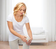 Unhappy woman suffering from pain in leg Royalty Free Stock Photography