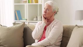 Unhappy woman suffering toothache at home stock footage