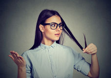 Unhappy woman surprised she is losing hair, receding hairline royalty free stock images