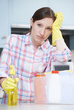 Unhappy Woman Surrounded By Cleaning Products At Home Royalty Free Stock Images