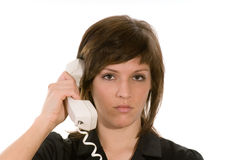 Unhappy woman with telephone Stock Image