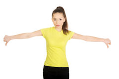 Unhappy woman with thumbs down. Royalty Free Stock Photo
