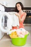 Unhappy  woman using washing machine Royalty Free Stock Photography