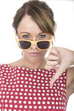 Unhappy Woman Wearing Sun Glasses Thumbs Down Royalty Free Stock Photo