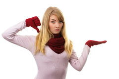 Unhappy woman in woolen gloves showing thumbs down, negative emotions Royalty Free Stock Images