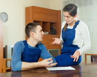Unhappy workers discussing financial documents Royalty Free Stock Images