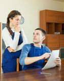 Unhappy workers with financial documents Stock Photos