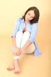 Unhappy Worried Attractive Beautiful Young Woman Sitting on the Floor Stock Photo