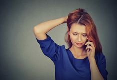 Unhappy worried woman talking on a phone royalty free stock photos