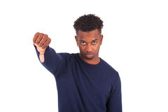 Unhappy young african american man making thumbs down gesture is Stock Image