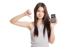 Unhappy Young Asian woman thumbs down with calculator Royalty Free Stock Photos