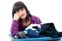 Unhappy young beautiful woman ironing clothes Stock Images