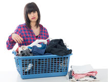 Unhappy young beautiful woman ironing clothes. An unhappy young beautiful woman ironing clothes Royalty Free Stock Photography
