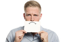 Upset businessman presenting blank white card. Stock Image