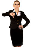 Unhappy young businesswoman with thumbs up.  Stock Image