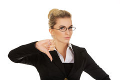 Unhappy young businesswoman with thumbs up Stock Photo