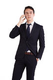 Unhappy young Caucasian business man holding mobile phone Royalty Free Stock Photos