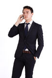 Unhappy young Caucasian business man holding mobile phone Royalty Free Stock Photo