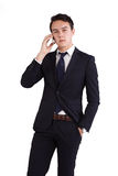 Unhappy young Caucasian business man holding mobile phone Stock Images