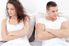 Unhappy young  couple in bedroom under stress Stock Images