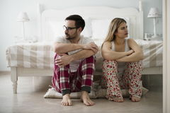 Unhappy young couple having difficulties in relationship stock photos