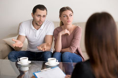 Unhappy young family couple with a problem at psychologist offic Royalty Free Stock Photo