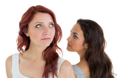 Unhappy young female friends not talking after argument Royalty Free Stock Photography