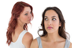 Unhappy young female friends not talking after argument Stock Images
