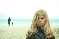 Unhappy young girl at the beach. Closeup portrait of unhappy young girl at the beach Royalty Free Stock Image