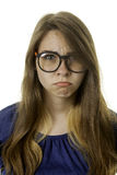 Unhappy young lady. Unhappy or scornfull expression on a young woman Royalty Free Stock Images