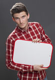 Unhappy young male student claiming his disappointment Stock Image