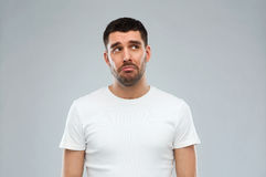 Unhappy young man over gray background Royalty Free Stock Photography