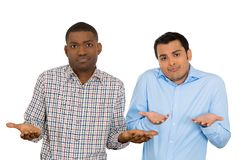 Unhappy young men arms out saying we dont know Royalty Free Stock Photography