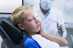 Unhappy young patient having a toothache Stock Photography