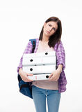 Unhappy young woman with backpack and folders Royalty Free Stock Images