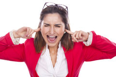 Unhappy young woman covering her ears and screamin Stock Images