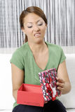 Unhappy young woman with gift boxes Stock Image