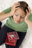 Unhappy young woman with gift boxes Royalty Free Stock Images