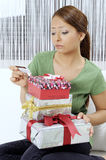 Unhappy young woman with gift boxes Royalty Free Stock Photography