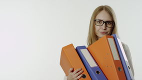 Unhappy young woman holding paper folders. Businesswoman holding many paper folders. Portrait of a depressed girl with work stock video