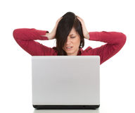 Unhappy, young woman with laptop Royalty Free Stock Image