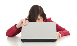 Unhappy, young woman with laptop Stock Images