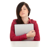 Unhappy, young woman with laptop Royalty Free Stock Images