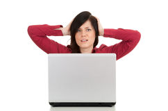 Unhappy, young woman with laptop Royalty Free Stock Photography