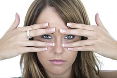 Unhappy Young Woman Peering Through Fingers Royalty Free Stock Photo