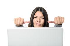 Unhappy Young Woman Showing Thumbs on Sides Stock Image